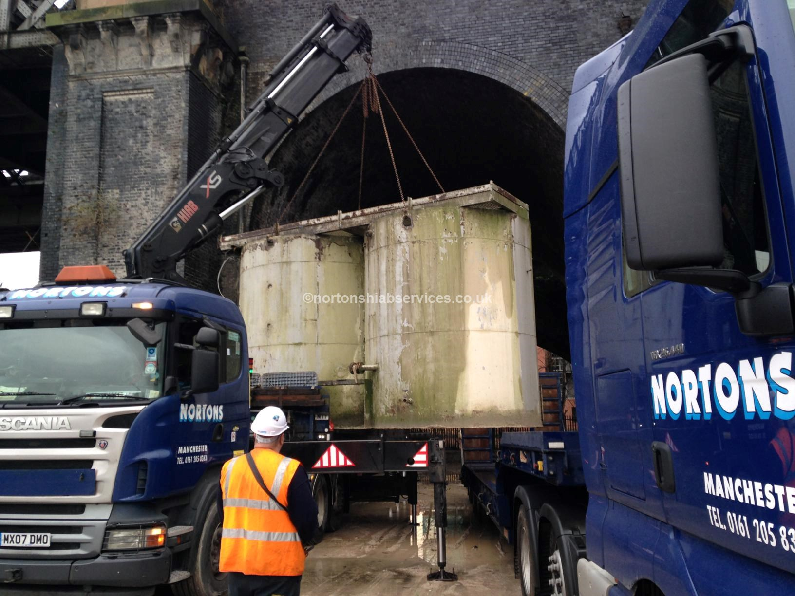 Moving cement hopper onto low loader